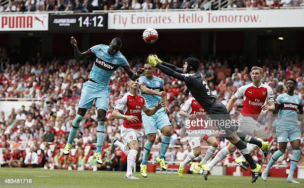 West Ham United's Senegalese midfielder Cheikhou Kouyate scores the opening goal of the English Premier League football match between Arsenal and...