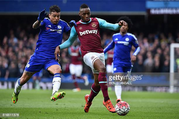 West Ham United's Senegalese striker Diafra Sakho vies with Chelsea's Brazilian striker Kenedy during the English Premier League football match...