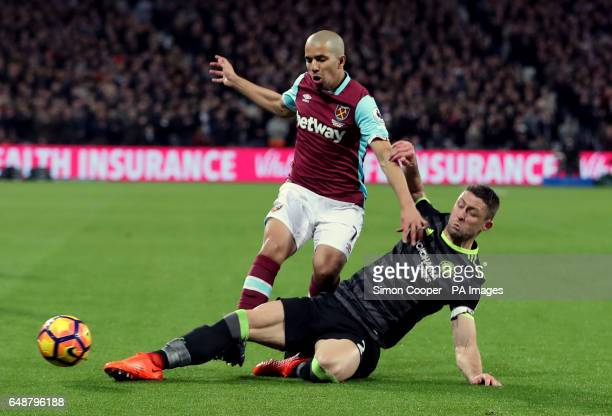 West Ham United's Sofiane Feghouli and Chelsea's Gary Cahill challenge for the ball during the Premier League match at the London Stadium