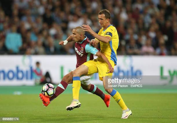 West Ham United's Sofiane Feghouli and NK Domzale's Kenan Horic in action