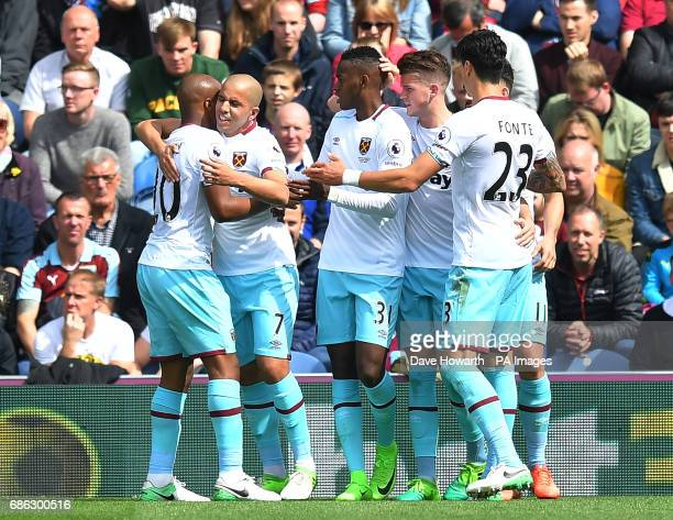 West Ham United's Sofiane Feghouli is congratulated on scoring his team's opening goal during the Premier League match at Turf Moor Burnley