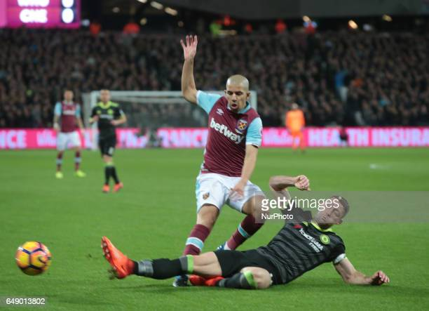West Ham United's Sofiane Feghouli is tackled by Chelsea's Gary Cahill during EPL Premier League match between West Ham United against Chelsea at The...