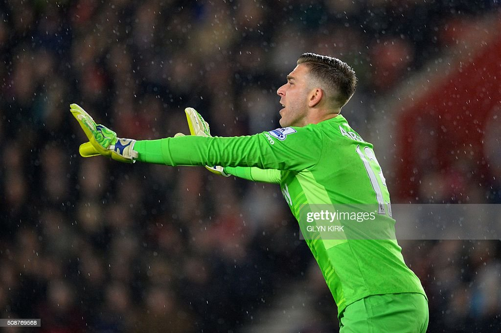 West Ham United's Spanish goalkeeper Adrian gestures during the English Premier League football match between Southampton and West Ham United at St Mary's Stadium in Southampton, southern England on February 6, 2016. / AFP / GLYN KIRK / RESTRICTED TO EDITORIAL USE. No use with unauthorized audio, video, data, fixture lists, club/league logos or 'live' services. Online in-match use limited to 75 images, no video emulation. No use in betting, games or single club/league/player publications. /