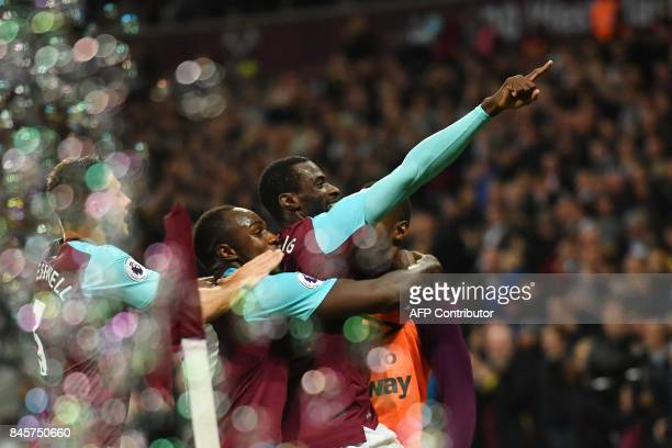 West Ham United's Spanish midfielder Pedro Obiang celebrates with teammates after scoring during the English Premier League football match between...