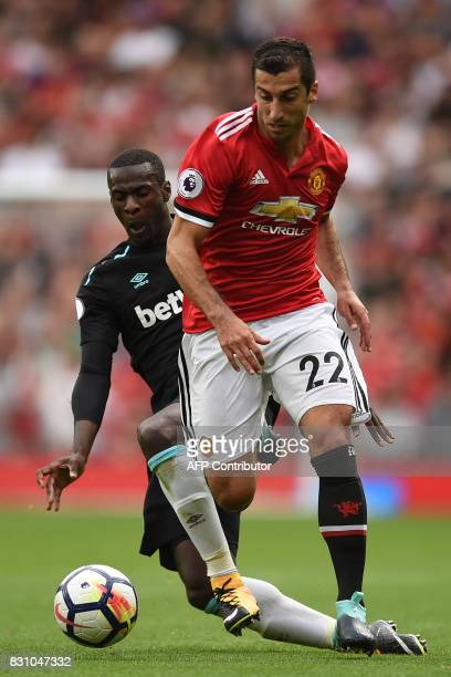 West Ham United's Spanish midfielder Pedro Obiang vies with Manchester United's Armenian midfielder Henrikh Mkhitaryan during the English Premier...