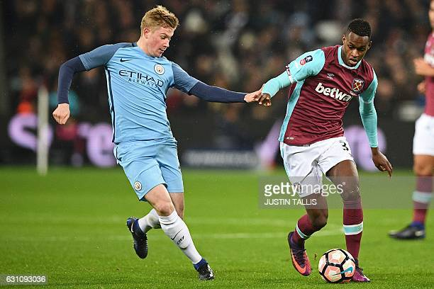 West Ham United's Swiss midfielder Edimilson Fernandes vies with Manchester City's Belgian midfielder Kevin De Bruyne during the English FA cup third...