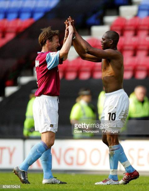 West Ham United's Teddy Sheringham and Marlon Harewood celebrate at the final whistle