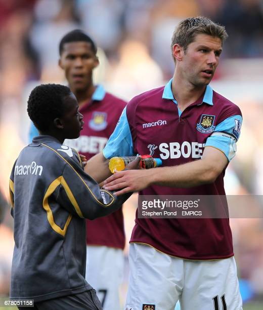 West Ham United's Thomas Hitzlsperger declines a bottle of Lucozade Sport form a ball boy after the final whistle