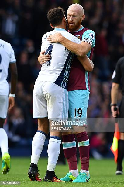 West Ham United's Welsh defender James Collins and West Bromwich Albion's Englishborn Welsh striker Hal RobsonKanu embrace during the English Premier...
