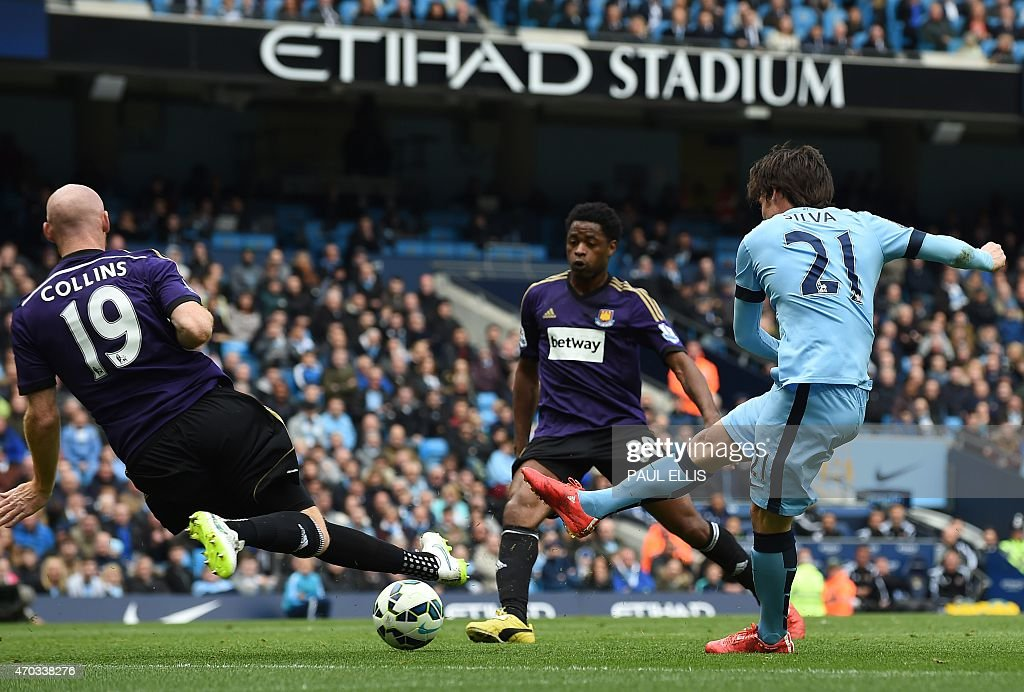 West Ham United's Welsh defender <a gi-track='captionPersonalityLinkClicked' href=/galleries/search?phrase=James+Collins+-+Voetballer+uit+Wales&family=editorial&specificpeople=15167252 ng-click='$event.stopPropagation()'>James Collins</a> (L) blocks a close-ranged shot from Manchester City's Spanish midfielder <a gi-track='captionPersonalityLinkClicked' href=/galleries/search?phrase=David+Silva&family=editorial&specificpeople=675795 ng-click='$event.stopPropagation()'>David Silva</a> (R) during the English Premier League football match between Manchester City and West Ham United at the Etihad Stadium in Manchester, north west England on April 19, 2015. AFP PHOTO / PAUL ELLIS USE. No use with unauthorized audio, video, data, fixture lists, club/league logos or live services. Online in-match use limited to 45 images, no video emulation. No use in betting, games or single club/league/player publications.