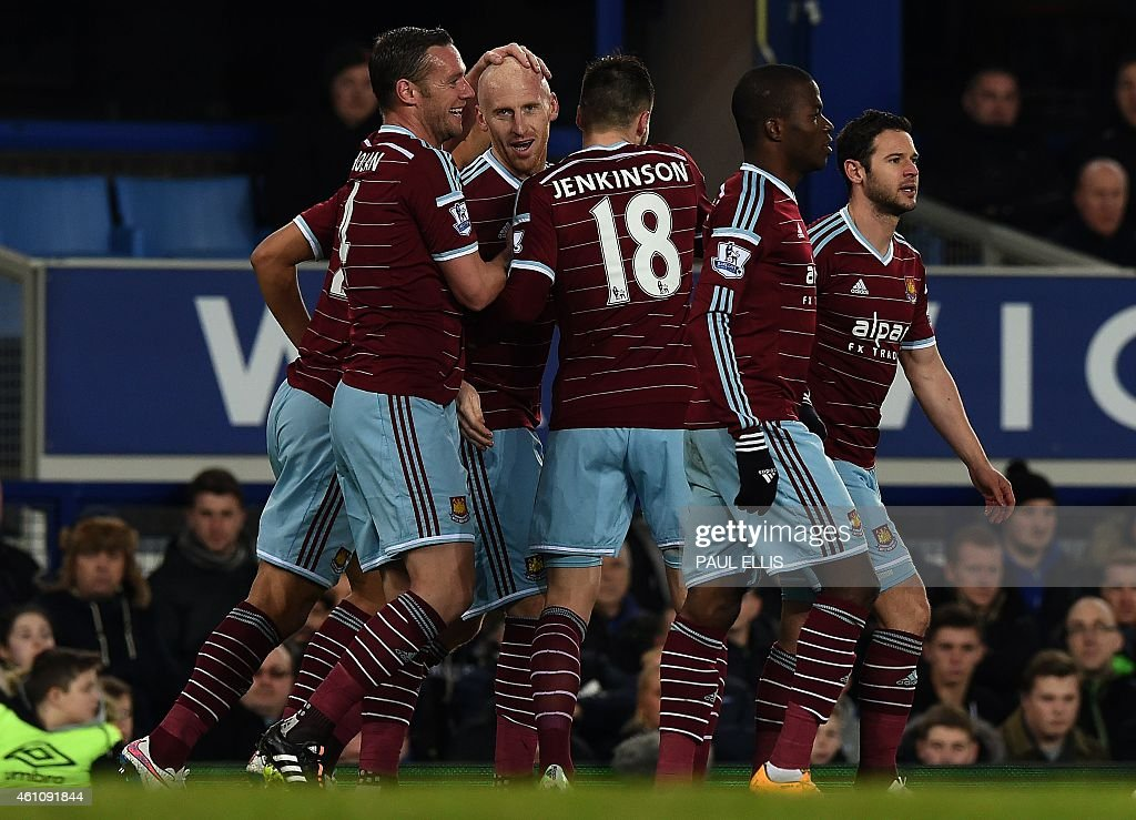 West Ham United's Welsh defender <a gi-track='captionPersonalityLinkClicked' href=/galleries/search?phrase=James+Collins+-+Voetballer+uit+Wales&family=editorial&specificpeople=15167252 ng-click='$event.stopPropagation()'>James Collins</a> (C) celebrates after scoring a goal during the English FA Cup Third Round football match between Everton and West Ham United at Goodison Park in Liverpool, north west England on January 6, 2015. AFP PHOTO/PAUL ELLIS - RESTRICTED TO EDITORIAL USE. NO USE WITH UNAUTHORIZED AUDIO, VIDEO, DATA, FIXTURE LISTS, CLUB/LEAGUE LOGOS OR LIVE SERVICES. ONLINE IN-MATCH USE LIMITED TO 45 IMAGES, NO VIDEO EMULATION. NO USE IN BETTING, GAMES OR SINGLE CLUB/LEAGUE/PLAYER PUBLICATIONS.