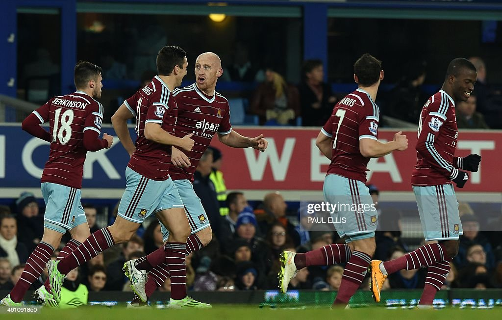 West Ham United's Welsh defender <a gi-track='captionPersonalityLinkClicked' href=/galleries/search?phrase=James+Collins+-+Voetballer+uit+Wales&family=editorial&specificpeople=15167252 ng-click='$event.stopPropagation()'>James Collins</a> (3-L) celebrates scoring a goal during the English FA Cup Third Round football match between Everton and West Ham United at Goodison Park in Liverpool, north west England on January 6, 2015.
