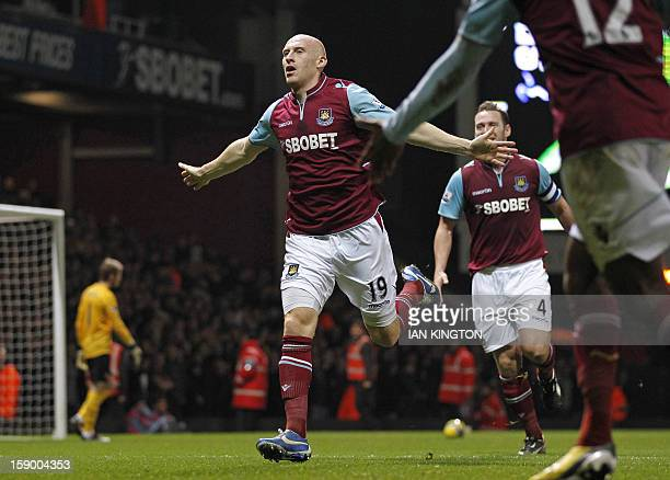 West Ham United's Welsh defender James Collins celebrates scoring their first goal during the English FA Cup third round football match between West...