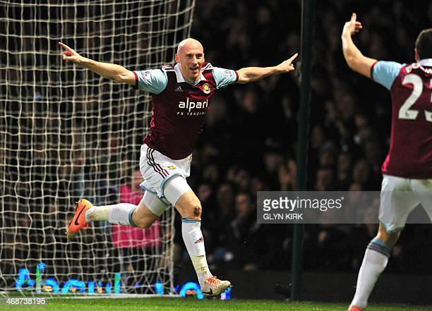 West Ham United's Welsh defender James Collins celebrates scoring the opening goal during the English Premier League football match between West Ham...