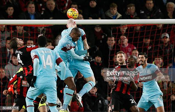 West Ham United's Welsh defender James Collins heads the ball toward goal during the English Premier League football match between Bournemouth and...