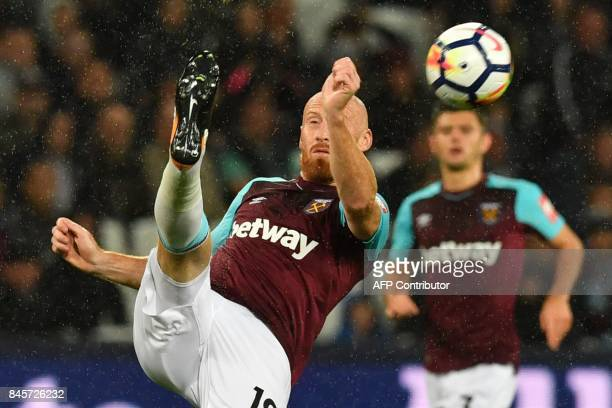 West Ham United's Welsh defender James Collins kicks the ball during the English Premier League football match between West Ham United and...