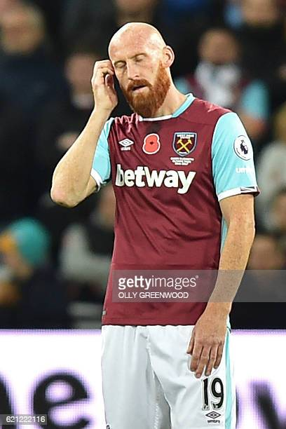 West Ham United's Welsh defender James Collins reacts after they concede a late goal during the English Premier League football match between West...