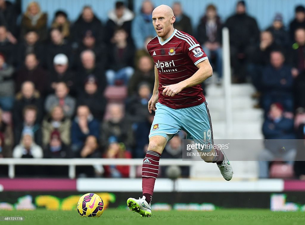 West Ham United's Welsh defender <a gi-track='captionPersonalityLinkClicked' href=/galleries/search?phrase=James+Collins+-+Voetballer+uit+Wales&family=editorial&specificpeople=15167252 ng-click='$event.stopPropagation()'>James Collins</a> runs with the ball during the English Premier League football match between West Ham United and Hull City at the Boleyn Ground, Upton Park, in east London, on January 18, 2015. West Ham won the game 3-0.