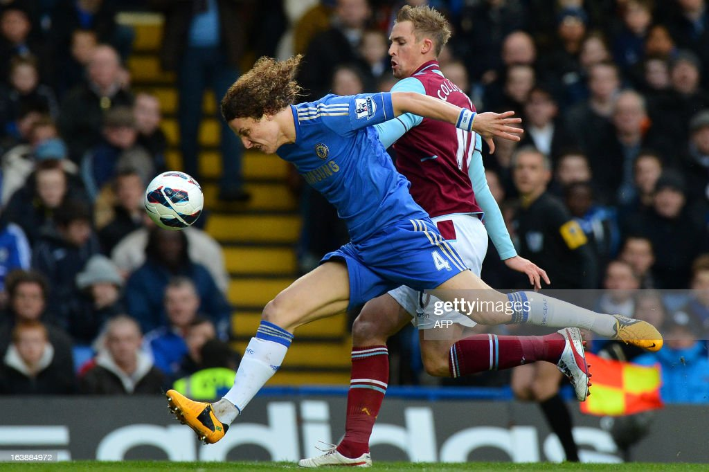 """West Ham United's Welsh midfielder Jack Collison (R) vies for the ball with Chelsea's Brazilian defender David Luiz (L) during the English Premier League football match between Chelsea and West Ham United at Stamford Bridge in London on March 17, 2013. USE. No use with unauthorized audio, video, data, fixture lists, club/league logos or """"live"""" services. Online in-match use limited to 45 images, no video emulation. No use in betting, games or single club/league/player publications."""