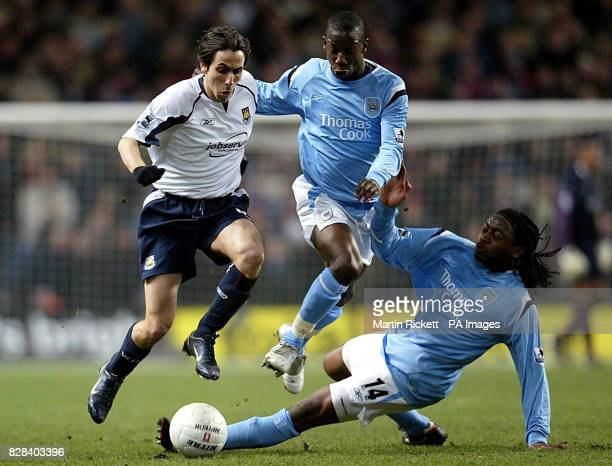 West Ham United's Yossi Benayoun is challenged by Manchester City's Kiki Musampa and Bradley WrightPhillips during the FA Cup sixth round match at...