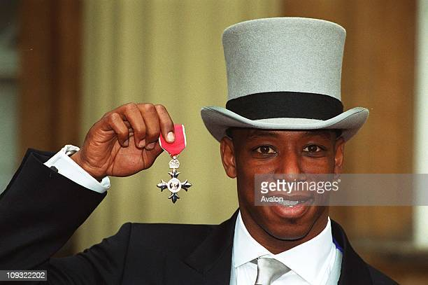 West Ham Utd FC and England International Footballer Ian Wright Mbe Outside Buckingham Palace after receiving the MBE