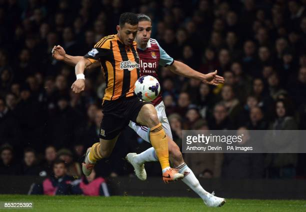 West Ham's Andy Carroll and Hull's Ahmed Elmohamady battle for possession during the Barclays Premier League match at Upton Park London