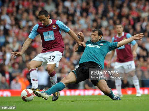 West Ham's David Di Michele in action with Liverpool's Javier Mascherano during the Barclays Premier League match at Upton Park London