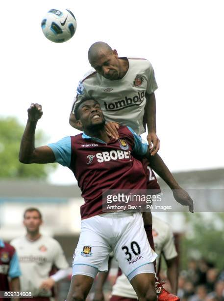 West Ham's Frederic Piquionne and Sunderland's Phil Bardsley compete for a header during the Barclays Premier League match at Upton Park London