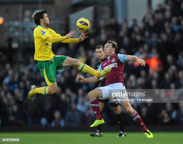 West Ham's Mark Noble and Norwich's Jonny Howson during the Barclays Premier League match at Upton Park London