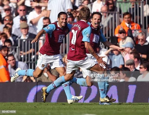 West Ham's Matthew Etherington celebrates scoring their second goal with team mates Hrita N'Kongolo Ilunga and Valon Behrami
