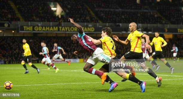 West Ham's Michail Antonio and West Ham's Daryl Janmaat during the Premier League match at Vicarage Road Watford