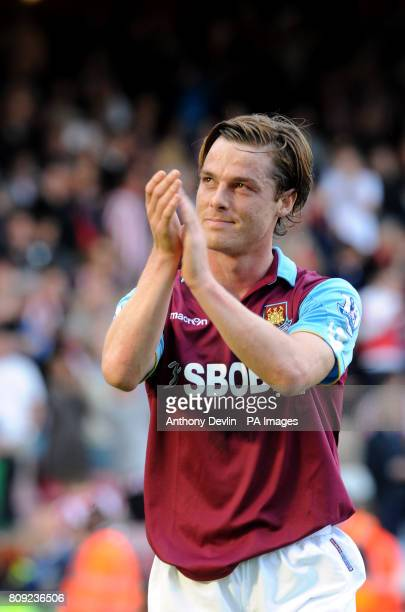 West Ham's Scott Parker acknowledges the fans following his teams defeat to Sunderland and relegation from the Premier League during the Barclays...