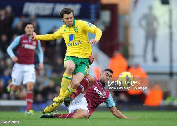 West Ham's Winston Reid and Norwich's Jonny Howson battle for the ball during the Barclays Premier League match at Upton Park London