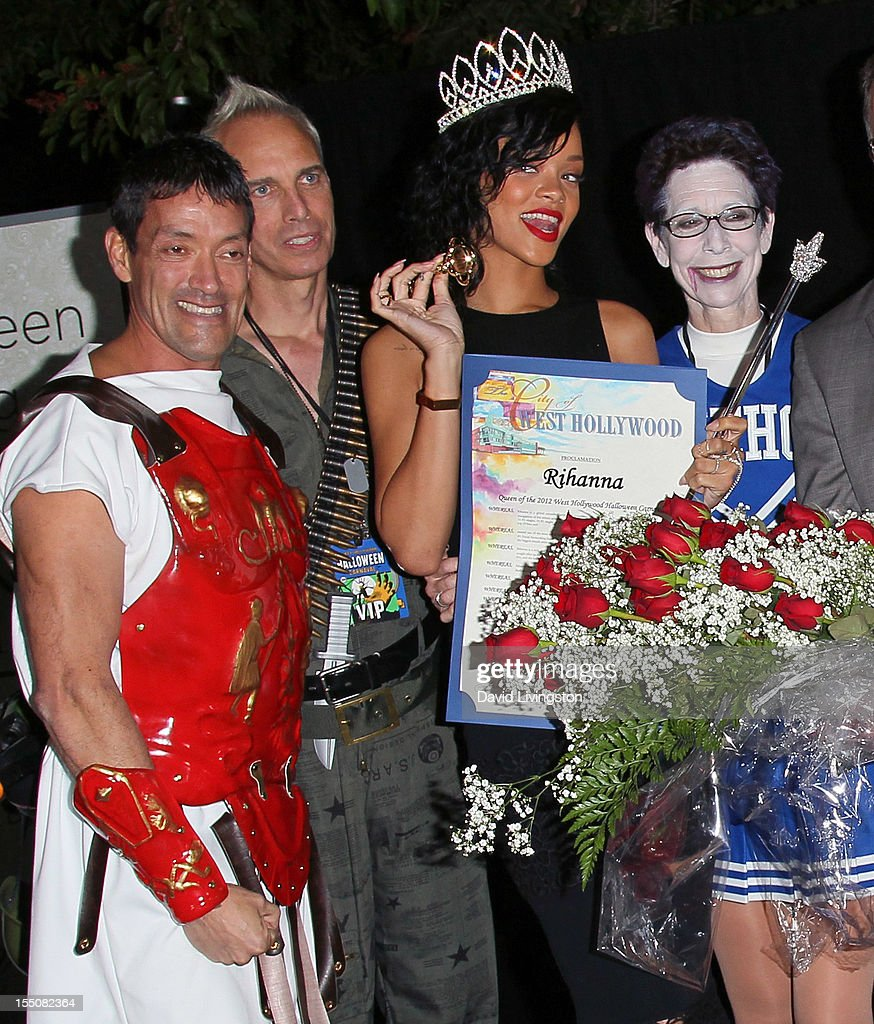 West Hollywood Councilmembers John J. Duran and John Heilman, recording artist <a gi-track='captionPersonalityLinkClicked' href=/galleries/search?phrase=Rihanna&family=editorial&specificpeople=453439 ng-click='$event.stopPropagation()'>Rihanna</a> and West Hollywood Mayor Pro Tempore Abbe Land attend <a gi-track='captionPersonalityLinkClicked' href=/galleries/search?phrase=Rihanna&family=editorial&specificpeople=453439 ng-click='$event.stopPropagation()'>Rihanna</a>'s naming as the Queen of the West Hollywood Halloween Carnaval by the City of West Hollywood in celebration of Halloween 2012 at Greystone Manor Supperclub on October 31, 2012 in West Hollywood, California.