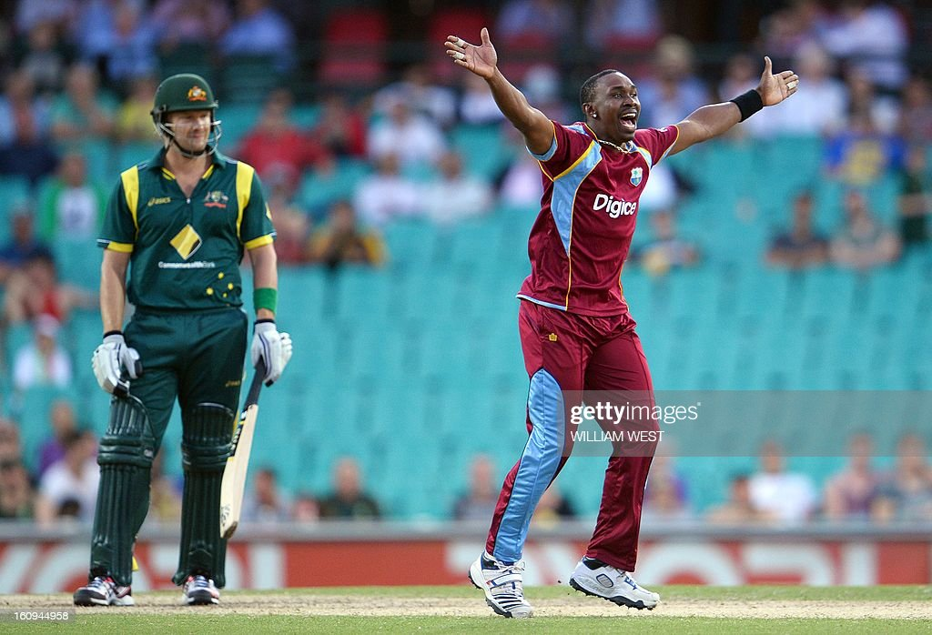 West Indian bowler Dwayne Bravo (R) appeals for a decision against Australian batsman Shane Watson (L) in their one-day cricket international played at the Sydney Cricket Ground on February 8, 2013. AFP PHOTO/William WEST IMAGE RESTRICTED TO EDITORIAL USE - STRICTLY NO COMMERCIAL USE