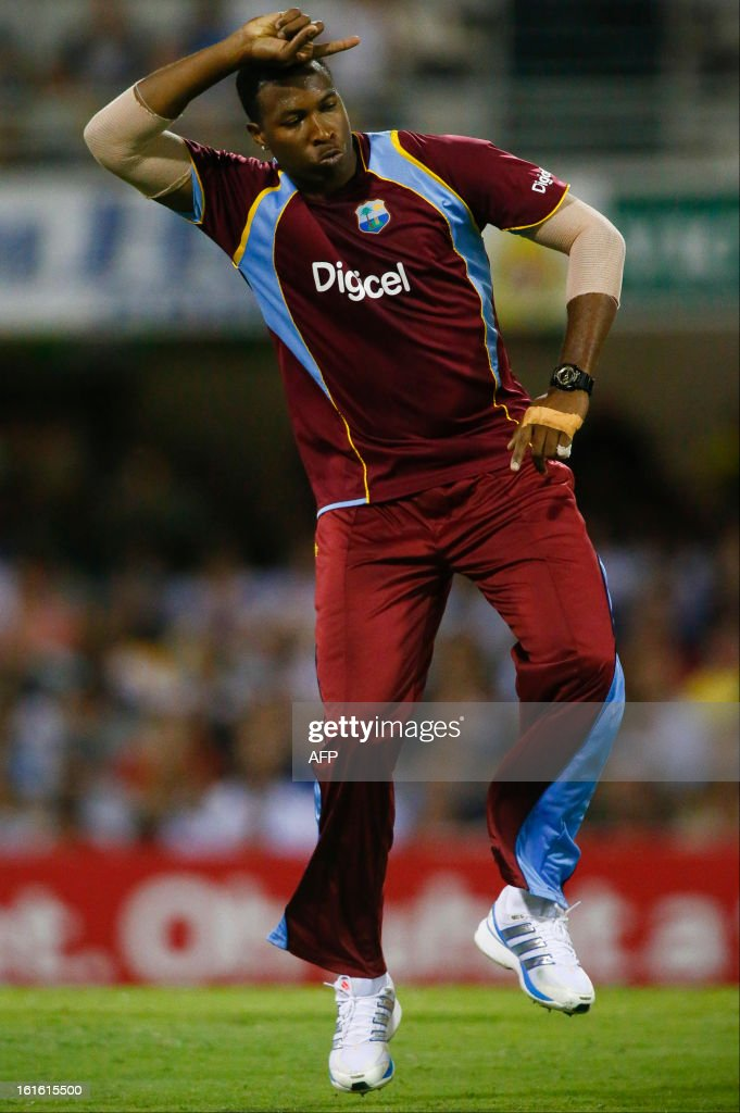 West Indian bowler Kieron Pollard cerebrates after dismissing Australia's James Faulkner during their international T20 cricket match at the Gabba cricket ground in Brisbane on February 13, 2013. AFP PHOTO / Patrick HAMILTON