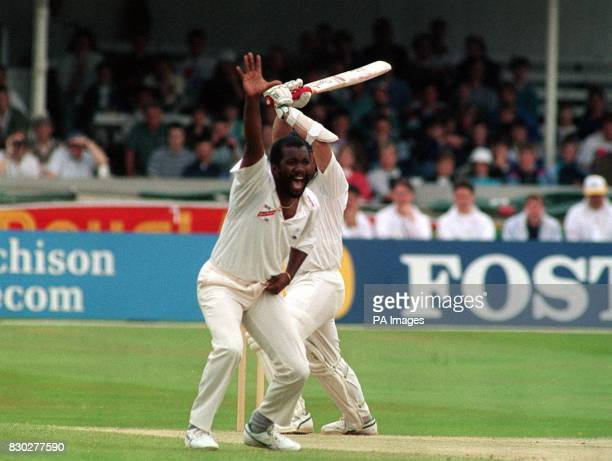 West Indian bowler Malcom Marshall celebrates the capture of England batsman Allan Lamb's wicket during their Test Match at Trent Bridge Nottingham