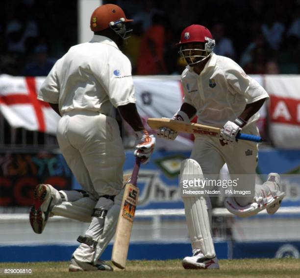 West Indian captain Brian Lara runs with Ridley Jacobs on his way to breaking the world record of 380 runs during the third day of the 4th Test at...