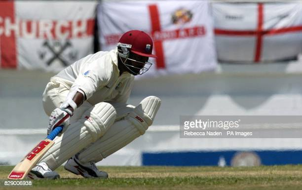 West Indian captain Brian Lara scores another run on his way to 400 runs not out and declaring on 751 against England during the third day of the 4th...