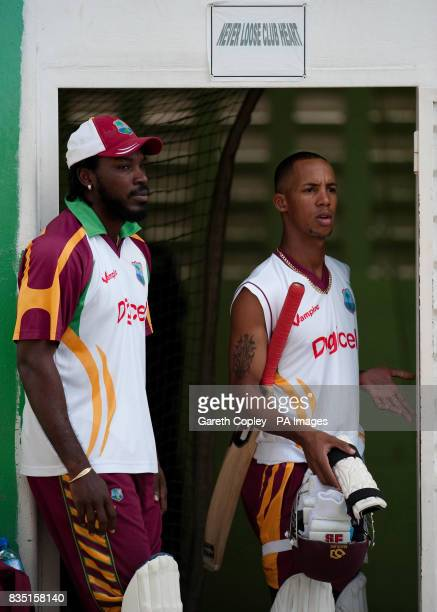 West Indian captain Chris Gayle with Lendl Simmons during a nets session at St Marys Sports Ground Port of Spain Trinidad