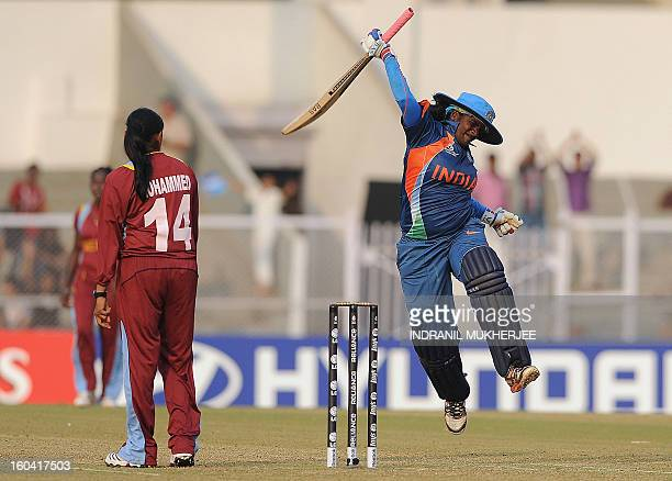 West Indian cricketer Anisa Mohammed looks on as Indian cricketer Thirush Kamini jumps in the air as she celebrate her century during the inaugural...