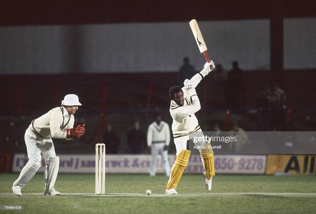 West Indian cricketer Malcolm Marshall plays an unusual shot during a floodlit cricket match between an invitation world XI and Surrey at Crystal...