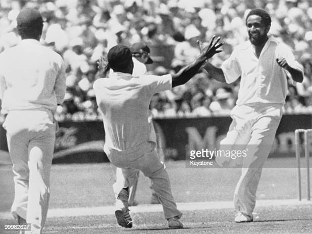 West Indian cricketer Viv Richards rushes towards Andy Roberts after he had bowled out Australia's Greg Chapell for no score during the third day of...