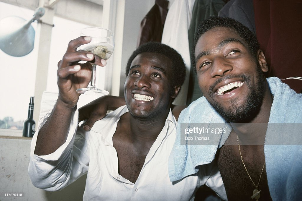 West Indian cricketers <a gi-track='captionPersonalityLinkClicked' href=/galleries/search?phrase=Viv+Richards&family=editorial&specificpeople=622151 ng-click='$event.stopPropagation()'>Viv Richards</a> (right) and Wayne Daniel, celebrate after the 4th Test match at Headingley in Leeds, 27th July 1976. The West Indies won by 55 runs, to win the series and retain the Wisden Trophy.