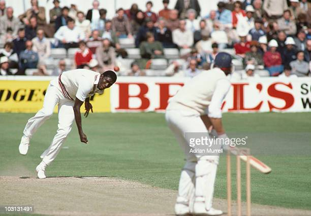 West Indian fast bowler Joel Garner in action for Somerset against Essex during a Benson and Hedges Cup match at Chelmsford May 1983