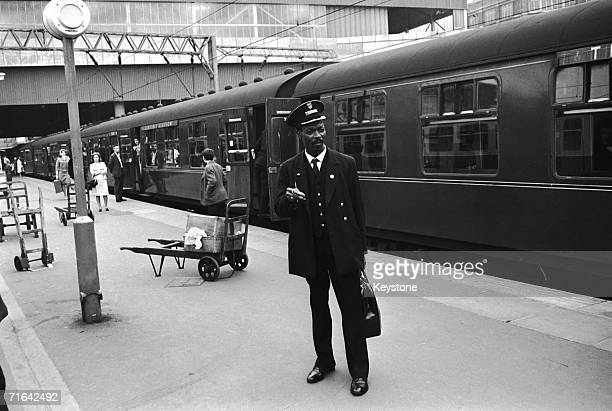 West Indian guard Asquith Xavier on his first day at work at Euston Station London 15th August 1966 Xavier is the first black guard to work at the...