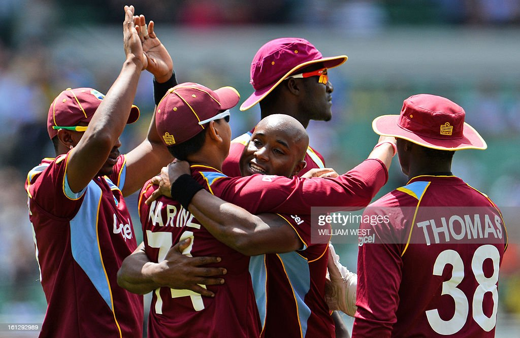 West Indian paceman Tino Best (C) celebrates with teammates after dismissing Australian batsman Aaron Finch in their one-day cricket international match played at the Melbourne Cricket Ground (MCG) on February 10, 2013. AFP PHOTO/William WEST IMAGE