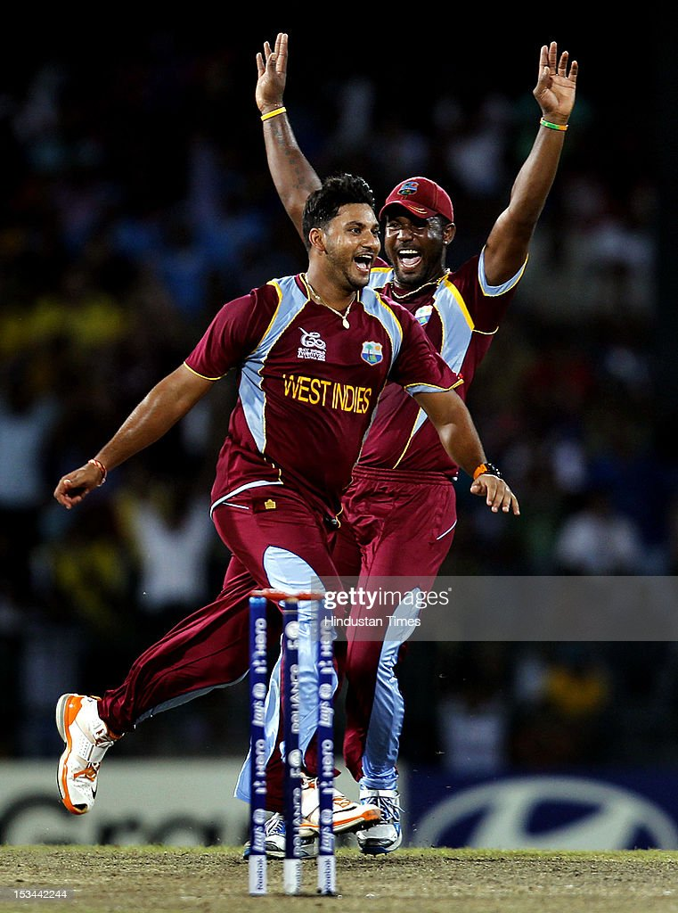 West Indien player <a gi-track='captionPersonalityLinkClicked' href=/galleries/search?phrase=Ravi+Rampaul&family=editorial&specificpeople=2924536 ng-click='$event.stopPropagation()'>Ravi Rampaul</a> celebrates after the dismissal of Australian batsman David Hussey during the ICC T20 World Cup cricket semi final match between Australia and West Indies at R. Premadasa Stadium on October 5, 2012 in Colombo, Sri Lanka.