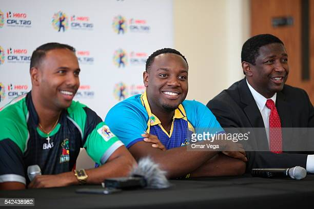 West Indies and St Kitts Nevis Patriots Samuel Badree Steven Taylor and Commissioner Dale VC Holness Broward County during a press conference for the...