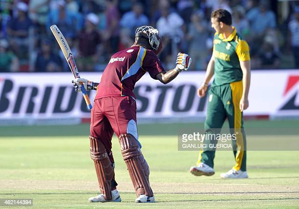 West Indies batsman Andre Russell celebrates after the West Indies won the match by one wicket during the 4th One Day International cricket match on...